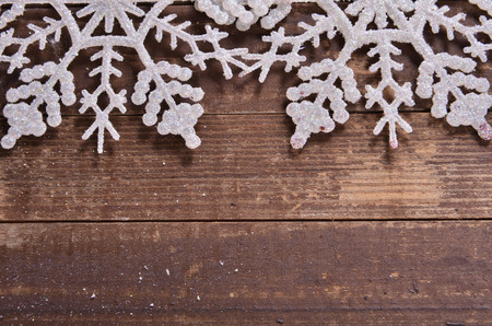 snowflakes on a wooden background