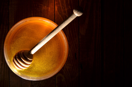 jar with honey and stick for honey Stock Photo