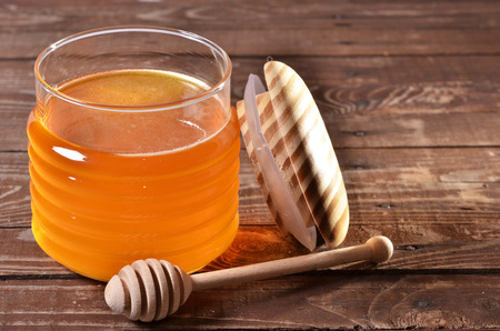 honey cell: jar with honey and stick for honey Stock Photo
