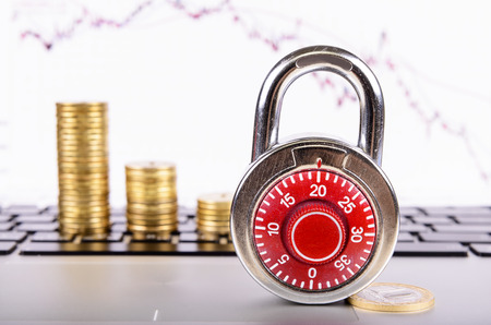 financial growth: padlock on a background of financial growth Stock Photo