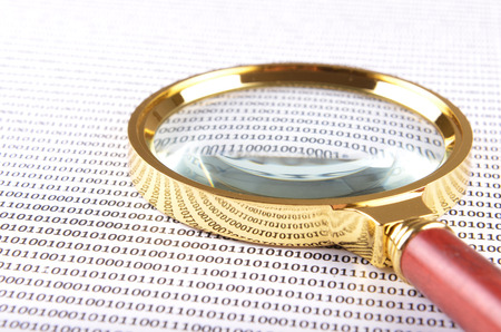 digital code: magnifying glass on the digital code