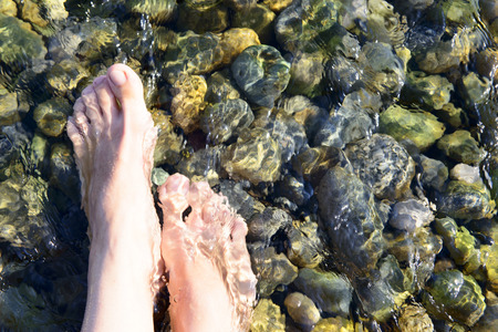 sea water: feet in the crystal clear sea water