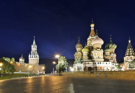 illuminated Basils Cathedral and Spasskaya Tower at night Stock Photo