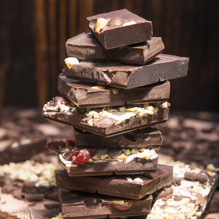 stack of chocolate on a wooden background