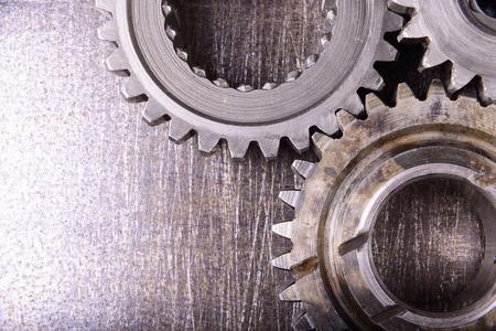 gears on metal background Standard-Bild