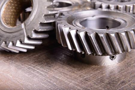 flywheel: gears on metal background Stock Photo
