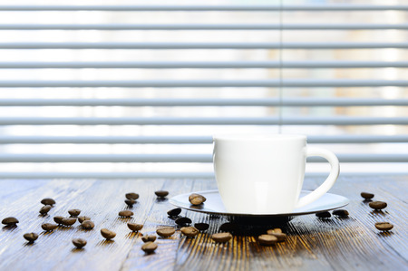 cup of coffee on the kitchen table photo