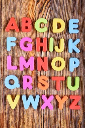 english letters: composition of colorful plastic alphabet letters