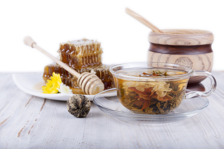 composition of green tea and honey on a white background
