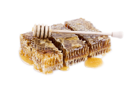honeycomb with honey and honey stick on white background