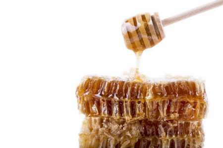 honeycomb with honey and honey stick Stock Photo
