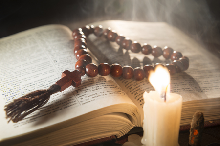 bible altar: candle with incense and holy book