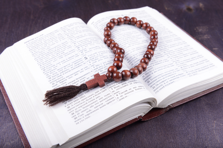 bible altar: holy book and cross on a wooden background Stock Photo