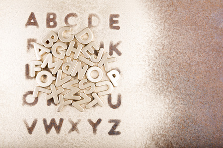 english alphabet: Gold English alphabet on a gold background Stock Photo