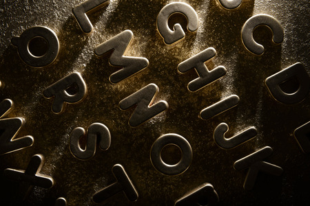 english alphabet: English alphabet on a gold background