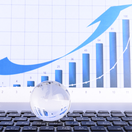 glass globe: business concept of a glass globe on a laptop keyboard