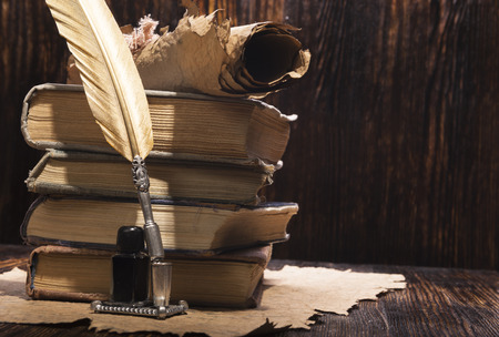 manuscripts: Vintage golden pen and ancient manuscripts Stock Photo
