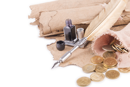 rewriting: coins, pen and ancient manuscripts on a white background Stock Photo