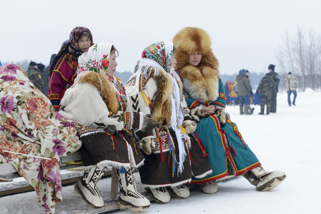 Nenets women in folk costumes at the Day of the reindeer herders on Yamal