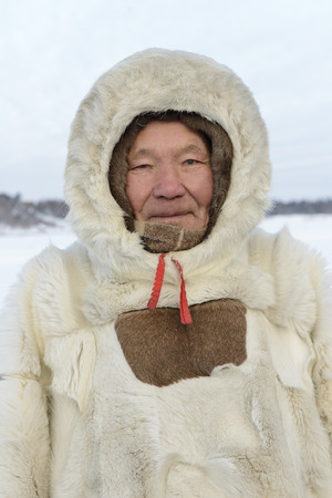 portrait of elderly Nenets in national clothes, malitsa. The Yamal Peninsula