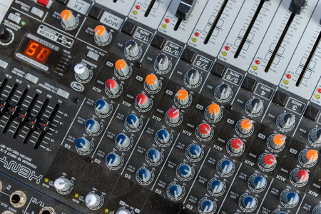 Professional sound engineers console. Remote control for the sound engineer