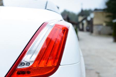 white car in a European village