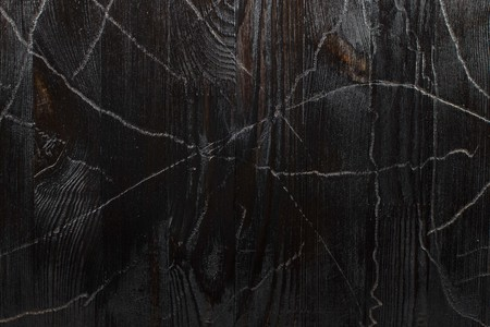 fading: Texture black burnt wood with faux fading and cracking