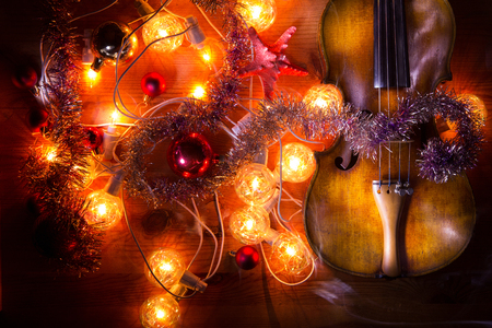 New Year composition with an old violin in dark colors