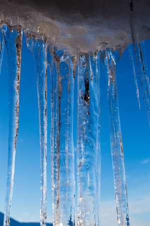 A lot of icicles over blue sky
