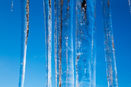Icicles in the blue sky 版權商用圖片