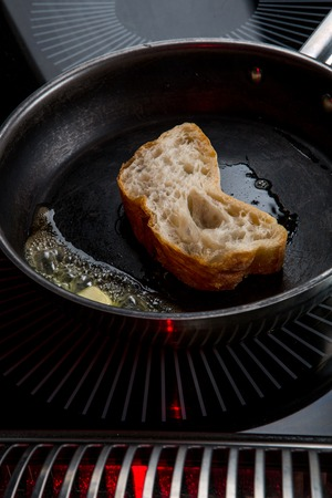the toast is fried in butter in a pan