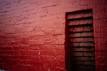niche in the red painted old brick wall 版權商用圖片
