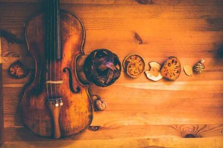 composition with an old violin in dark colors on table