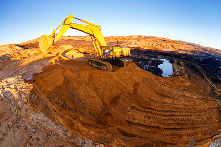 heavy equipment: open mining pit with heavy machinery Stock Photo