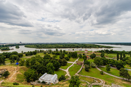 Belgrade fortress and Kalemegdan park with dramatic clouds and green foliage