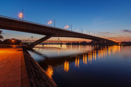 Bridge across river Sava at night with artificial lightning, Belgrade Serbia Stock Photo