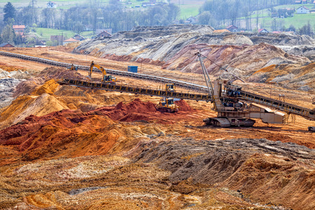 open mining pit with heavy machinery Stock Photo
