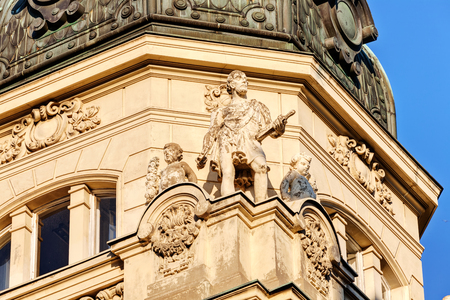 stone facade on classical building with ornaments and sculptures Stock Photo