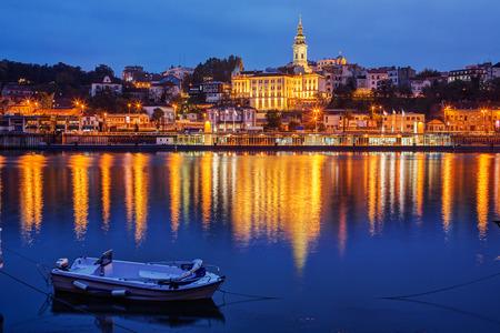 Panorama of Belgrade at night with small boat Stock Photo