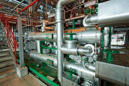 detail of oil pipeline with valves in large oil refinery Stock Photo