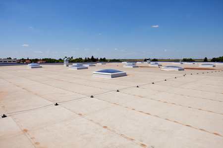 Flat roof with skylight and hydro insulation membranes Banco de Imagens - 84998420