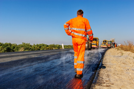 roller compactor: road making with heavy machines Stock Photo