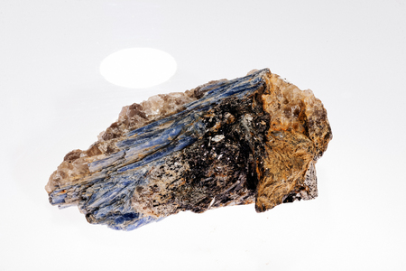 kyanite mineral with garnets on the white background Stock Photo