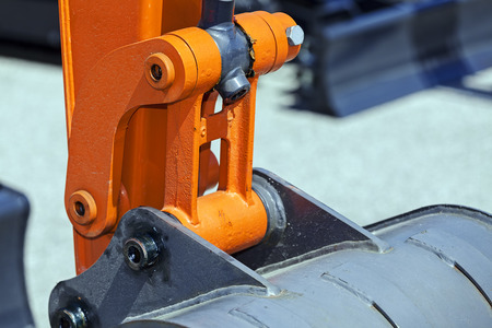 View on detail of new excavator digging; note shallow depth of field