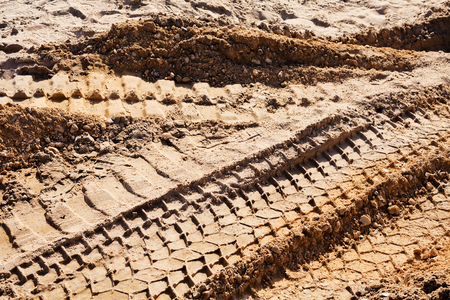 sand quarry: smaller sand with tire tracks in construction Stock Photo