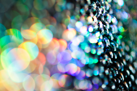reflections of light multi color on the rough metal surface, for blurred background