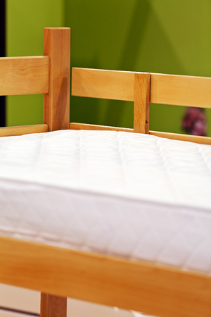 leather texture: Detail of classic furniture bed in bedroom. Stock Photo