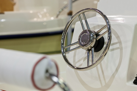 new powerful chrome steering wheel for boat; note shallow depth of field