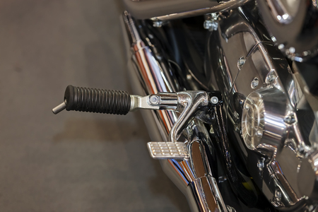 Chrome detail of motorcycle leg holder with rubber; note shallow depth of field