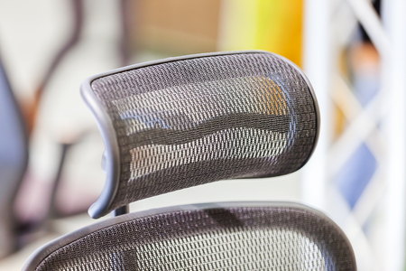 type head restraints on the chair, note shallow depth of field
